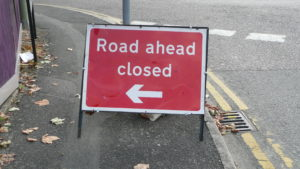 "Sign reading ""Road ahead closed"""