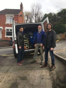 Councillor Paul Dixon with Imtiyaz Shaikh and Patrick Herring by a van full of rubbish